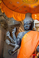 Cambodia, Angkor Wat.  Vishnu Statue inside the Entrance to the temple.