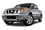 Low aggressive front three quarter view of a 2013 Nissan Titan SL Crew Cab 2wd