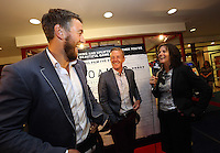 """Pictured: Manager Garry Monk (C) shares a joke with rugby player Ryan Jones (L) while being interviewed. Sunday 14 September 2014<br /> Re: Film premiere of """"Jack To A King"""" depicting the recent history pf Swansea City Football Club, at the Odeon Cinema, Swansea, south Wales, UK."""