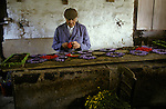 Tissington Well Dressing, a local man makes a  wild flower floral display boards. Derbyshire UK