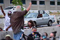 Washington, DC - June 15, 2020: A motorist, stuck in traffic caused by protesters blocking I-395, shows support June 15, 2020 to call for police justice and reform in the wake of the police killing of George Floyd in Minnesota.  (Photo by Don Baxter/Media Images International)