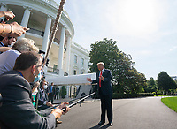 United States President Donald J. Trump speaks to members of the media on the South Lawn of the White House in Washington D.C., U.S., as he departs for Yuma, Arizona on Tuesday, June 23, 2020.  Trump stated that he authorized the Federal government to arrest any demonstrator caught vandalizing U.S. monuments, with a punishment of up to 10 years in prison.  Credit: Stefani Reynolds / CNP/AdMedia