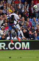 Pictured: Kyle Naughton of Swansea (R) heads the ball while is challenged by Wilfried Zaha of Crystal Palace<br />