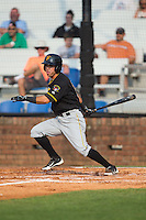 Edgar Figueroa (13) of the Bristol Pirates follows through on his swing against the Johnson City Cardinals at Howard Johnson Field at Cardinal Park on July 6, 2015 in Johnson City, Tennessee.  The Pirates defeated the Cardinals 2-0 in game one of a double-header. (Brian Westerholt/Four Seam Images)