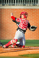 Delaware State Hornets catcher Eddie Sorondo (22) throws the ball back to his pitcher during the game against the Charlotte 49ers at Robert and Mariam Hayes Stadium on February 15, 2013 in Charlotte, North Carolina.  The 49ers defeated the Hornets 13-7.  (Brian Westerholt/Four Seam Images)