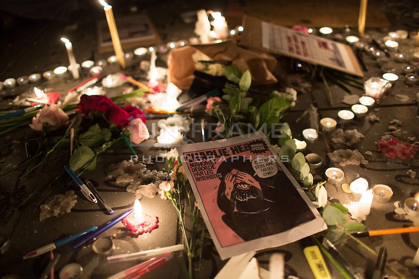 Pens, candles, and printouts left by demonstrators at Place de la Republique following the massacre at Charlie Hebdo in Paris where masked gunmen killed 12 people. Paris, France, (Jan. 7, 2015).