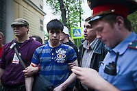 Moscow, Russia, 12/05/2012..Protesters seize and hand to the police a man attempting to steal a mobile phone from a woman  in the crowd in Chistiye Prudy, or Clean Ponds, a park in central Moscow were some 200 opposition activists have set up camp.
