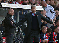 Arsenal manager Arsene Wenger complains to the fourth official during the Barclays Premier League match between Swansea City and Arsenal played at The Liberty Stadium, Swansea on October 31st 2015