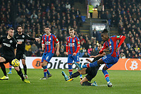 GOAL - Wilfried Zaha of Crystal Palace shoots and scores during the Premier League match between Crystal Palace and Brighton and Hove Albion at Selhurst Park, London, England on 16 December 2019. Photo by Carlton Myrie / PRiME Media Images.