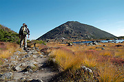 A hiker on Star Lake Trail. Star Lake is just in front of Mount Madison, which is in the beautiful scenic landscape of the  Northern Presidential Range. Located in the White Mountain National Forest of New Hampshire USA