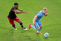 WASHINGTON, DC - SEPTEMBER 06: Donovan Pines #23 of D.C. United defends Gary Mackay-Steven #17 of New York City FC during a game between New York City FC and D.C. United at Audi Field on September 06, 2020 in Washington, DC.