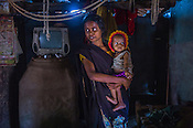 21 year old, Rekha RAMESH seen with her 18 month old Prahlad RAMESH, a recovering malnourished boy in their house in Dhawati VIllage of Khaknar block of Burhanpur district in Madhya Pradesh, India.  Photo: Sanjit Das/Panos for ACF