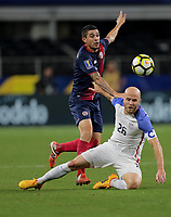 Arlington, TX - Saturday July 22, 2017: José Salvatierra and Michael Bradley during a 2017 Gold Cup Semifinal match between the men's national teams of the United States (USA) and Costa Rica (CRC) at AT&T stadium.