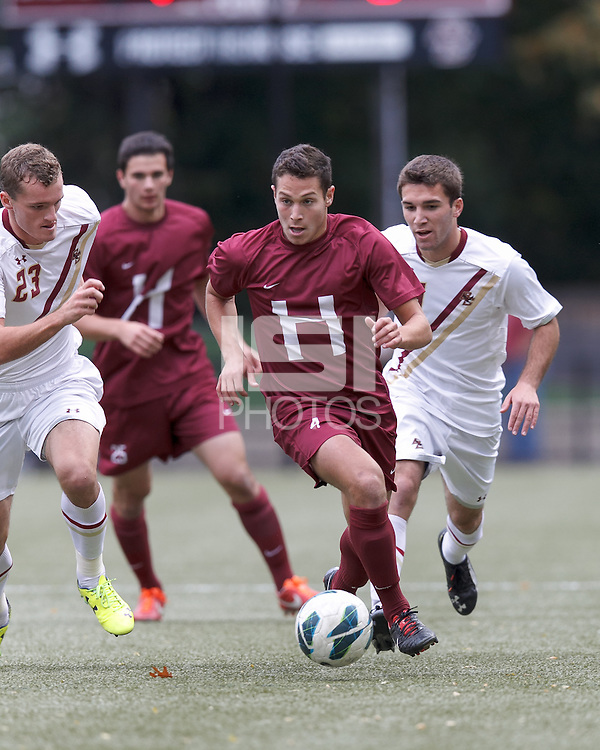 Harvard University defender Ross Friedman (4) works to clear ball.Boston College (white) defeated Harvard University (crimson), 3-2, at Newton Campus Field, on October 22, 2013.