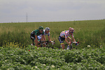 The breakaway group led by Polka Dot Jersey Michael Morkov (DEN) Saxo Bank-Tinkoff Bank with Christophe Kern (FRA) Team Europcar and Anthony Roux (FRA) FDJ BigMat pass through flat farmland near the village of Limont during Stage 2 of the 99th edition of the Tour de France 2012, running 207.5km from Vise to Tournai, Belgium. 2nd July 2012.<br /> (Photo by Eoin Clarke/NEWSFILE)