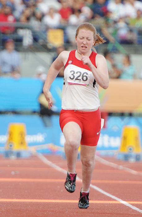 Virginia McLachlan, Guadalajara 2011 - Para Athletics // Para-athlétisme.<br /> Virginia McLachlan on her way to a silver medal in the women's 100m - T38 // Virginia McLachlan en route vers une médaille d'argent au 100 m femmes - T38. 11/17/2011.