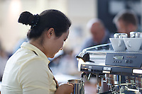 MELBOURNE, 13 April 2014 - Di Wang from SA competing in the AASCA Australian Latte Art Championship held at 16 River Street, Richmond, Victoria. Photo Sydney Low.