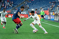 FOXBOROUGH, MA - MAY 1: Marcelino Moreno #10 of Atlanta United FC under pressure from Brandon Bye #15 of New England Revolution during a game between Atlanta United FC and New England Revolution at Gillette Stadium on May 1, 2021 in Foxborough, Massachusetts.