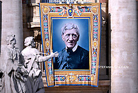 tapestry portraying Cardinal John Henry Newman hangs from the facade of St. Peter's Basilica, at the Vatican. Pope Francis during  Canonization Mass for English John Henry Newman, Italian Giuseppina Vannini, Indian Maria Teresa Chiramel Mankidiyan, Brazilian Dulce Lopes Pontes, and Swiss Margarita Bays on October 13, 2019 In Saint Peter's square at the Vatican.
