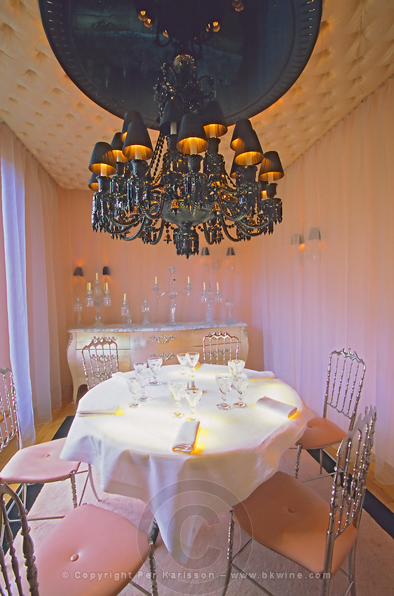 "The private dining room with the black crystal chandelier at The Baccarat Restaurant ""Le Cristal Room"", in the old dining room. Crystal chandeliers and glasses. Designed by Philippe Starck."