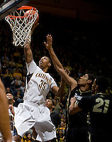 Richard Solomon of California prepares to dunk the ball during the game against Colorado Buffaloes at Haas Pavilion in Berkeley, California on March 2nd, 2013.  California defeated Colorado Buffaloes, 62-46.
