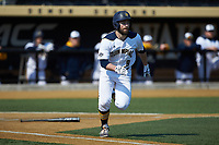 Ryan Nelson (8) of the Quinnipiac Bobcats hustles down the first base line against the Radford Highlanders at David F. Couch Ballpark on March 4, 2017 in Winston-Salem, North Carolina. The Highlanders defeated the Bobcats 4-0. (Brian Westerholt/Four Seam Images)