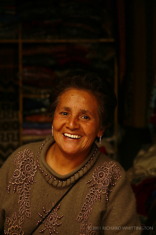 A vendor at the Pisac market shows off her beautiful smile.