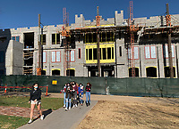 A group of visitors to the University of Arkansas campus is led on a tour Thursday, Nov. 19, 2020, as work continues on a Student Success Center on the university campus in Fayetteville. Visit nwaonline.com/201120Daily/ for today's photo gallery. <br /> (NWA Democrat-Gazette/Andy Shupe)