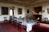 The dining room with its table laid ready for a candle lit dinner