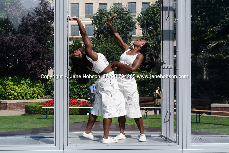 """London, UK. 05.09.2021.Alleyne Dance present """"Bonded"""", in Westferry Circus, as part of Greenwich and Docklands International Festival. <br /> <br /> Choreographed and Performed by: Kristina Alleyne & Sadé Alleyne<br /> Produced By: Uprise Rebel<br /> Production Manager: Salvatore Scollo<br /> Composer: Giuliano Modarelli<br /> Illustrator: Genevieve Edwards<br /> Set Designer: Emanuele Salamanca<br /> Costume: Giulia Scrimieri<br /> Textiles Developer: Elizabeth Mary Clay Roberts<br /> Costume Assistant: Hania Kosewicz<br /> Funders: Supported by Without Walls and commissioned by Norfolk &<br /> Norwich Festival and Salisbury International Arts Festival, part of Wiltshire Creative<br /> Photograph © Jane Hobson."""