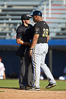 Bristol Pirates manager Miguel Perez (28) gets in the face of home plate umpire Justin Juska after being ejected from the game against the Danville Braves at American Legion Post 325 Field on July 1, 2018 in Danville, Virginia. The Braves defeated the Pirates 3-2 in 10 innings. (Brian Westerholt/Four Seam Images)