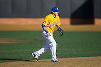 Delaware Blue Hens shortstop Brock Niggebrugge (5) on defense against the Georgetown Hoyas at Wake Forest Baseball Park on February 13, 2015 in Winston-Salem, North Carolina.  The Blue Hens defeated the Hoyas 3-0.  (Brian Westerholt/Four Seam Images)