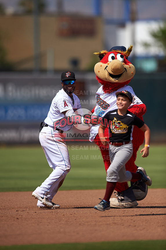 Inland Empire 66ers shortstop Luis Rengifo (3) helps a young contestant by wrestling with the 66ers mascot, Bernie, during a California League game against the Lancaster JetHawks at San Manuel Stadium on May 20, 2018 in San Bernardino, California. Inland Empire defeated Lancaster 12-2. (Zachary Lucy/Four Seam Images)
