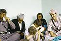 Irak 1991  Nechirvan Barzani reçu chez une famille à Dohok avec a gauche, Fazel Mirani              Iraq 1991   Nechirvan Barzani visiting a family in Dohok with left  Fazel Mirani