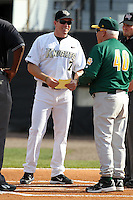 UCF Knights coach Ryan Klosterman #7 talks with Tony Rossi #40 before a game against the Siena Saints at the UCF Baseball Complex on March 3, 2012 in Orlando, Florida.  UCF defeated Siena 6-4.  (Mike Janes/Four Seam Images)