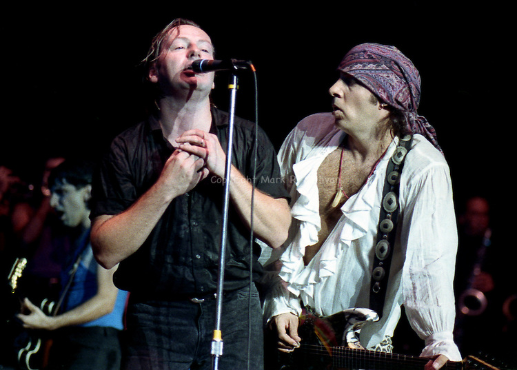 "Southside Johnny (left) is joined on stage by ""Little Steven"" Van Zandt during a Southside Johnny and the Asbury Juks show at the Garden State Arts Center in Holmdel, New Jersey...1990.."