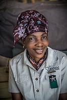 Africa, Botswana, Okavango Delta, Khwai private reserve, woman working a Khwai Private Reserve.