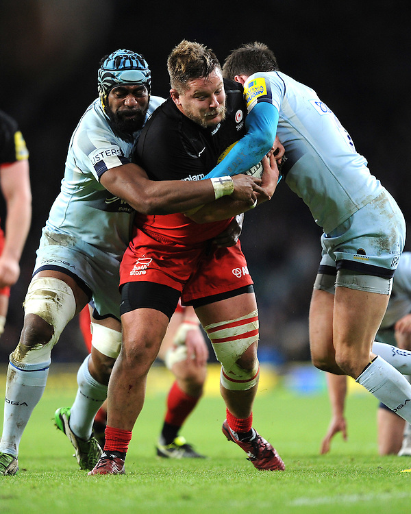 Richard Barrington of Saracens is tackled by Tevita Cavubati and Ben Howard of Worcester Warriors during the Premiership Rugby match between Saracens and Worcester Warriors - 28/11/2015 - Twickenham Stadium, London<br /> Mandatory Credit: Rob Munro/Stewart Communications