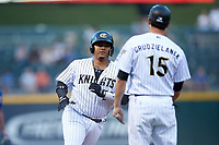 Yermin Mercedes (27) of the Charlotte Knights is greeted by  third base coach Mark Grudzielanek (15) as he rounds the bases after hitting a home run against the Durham Bulls at BB&T BallPark on July 31, 2019 in Charlotte, North Carolina. The Knights defeated the Bulls 9-6. (Brian Westerholt/Four Seam Images)
