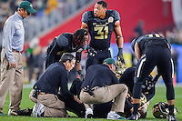January 01, 2014:<br /> <br /> Baylor Bears defensive end Shawn Oakman #2 is attended by doctors after suffering injury during Tostitos Fiesta Bowl at University of Phoenix Stadium in Scottsdale, AZ. UCF defeat Baylor 52-42 to claim it's first ever BCS Bowl trophy.