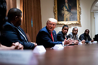 United States President Donald J. Trump makes remarks as is surrounded by African-American supporters in the Cabinet Room of the White House, Tuesday, June, 10, 2020.  <br /> Credit: Doug Mills / Pool via CNP/AdMedia