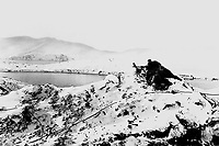 On high ground overlooking an icy inlet in Alaska, U.S. Marines man a machine gun at a lookout post.  Ca. 1942-43.  Marine Corps.  (OWI)<br /> Exact Date Shot Unknown<br /> NARA FILE #:  208-N-8480<br /> WAR & CONFLICT BOOK #:  1146