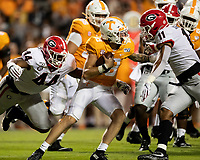 KNOXVILLE, TN - OCTOBER 5: Travon Walker #44 and Jermaine Johnson #11 of the Georgia Bulldogs tackle Brian Maurer #18 of the Tennessee Volunteers during a game between University of Georgia Bulldogs and University of Tennessee Volunteers at Neyland Stadium on October 5, 2019 in Knoxville, Tennessee.
