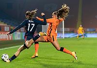 BREDA, NETHERLANDS - NOVEMBER 27: Tobin Heath #17 of the USWNT crosses the ball in front of Lieke Martens #11 of the Netherlands during a game between Netherlands and USWNT at Rat Verlegh Stadion on November 27, 2020 in Breda, Netherlands.