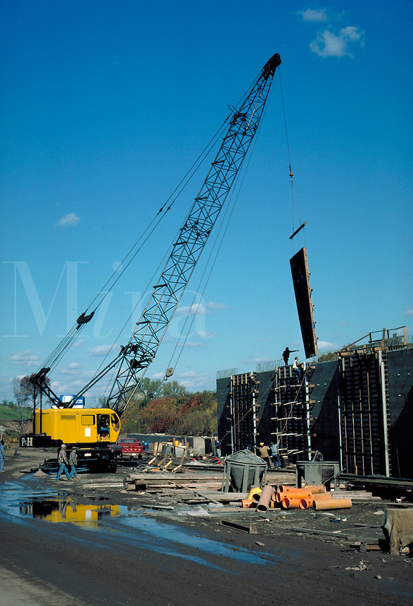 Crane lifting concrete forms, vert. Hartford CT USA.