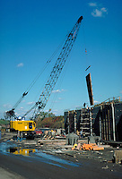 Crane lifting concrete forms, vert. Hartford CT USA.