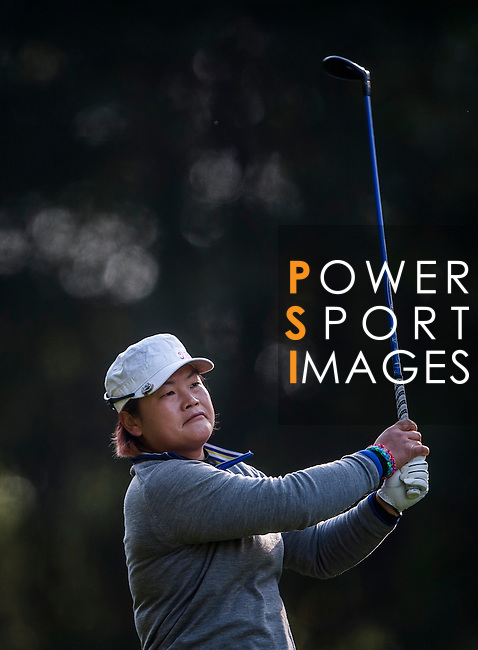 Yanhong Pan of China in action during the Hyundai China Ladies Open 2014 at World Cup Course in Mission Hills Shenzhen on December 13 2014, in Shenzhen, China. Photo by Xaume Olleros / Power Sport Images