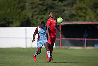 Cameron Gray of Flackwell Heath & Essa Sabally of Tuffley Rovers during the UHLSport Hellenic Premier League match between Flackwell Heath v Tuffley Rovers at Wilks Park, Flackwell Heath, England on 20 April 2019. Photo by Andy Rowland.
