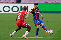 29th April 2021; Camp Nou, Barcelona, Catalonia, Spain; La Liga Football, Barcelona versus Granada; Jordi Alba of Barcelona plays the ball past Foulquier of Granada CF