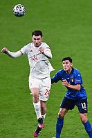6th July 2021; Wembley Stadium, London, England; Euro 2020 Football Championships semi-final, Italy versus Spain; Matteo Pessina beaten to the header by Aymeric Laporte (Esp)